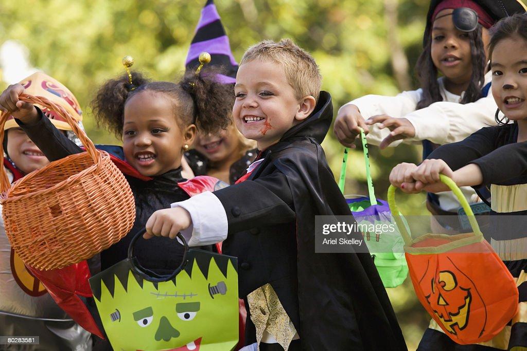 Multi-ethnic children dressed in Halloween costumes : Stock Photo