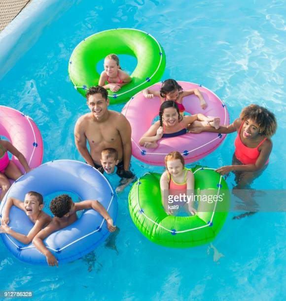 Multi-ethnic children, fun on lazy river at water park