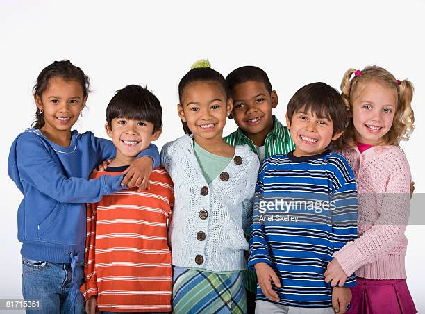 multi-ethnic children hugging - children only stock pictures, royalty-free photos & images