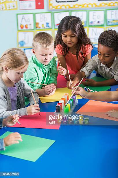 multi-ethnic children in kindergarten doing art project - art and craft stock pictures, royalty-free photos & images