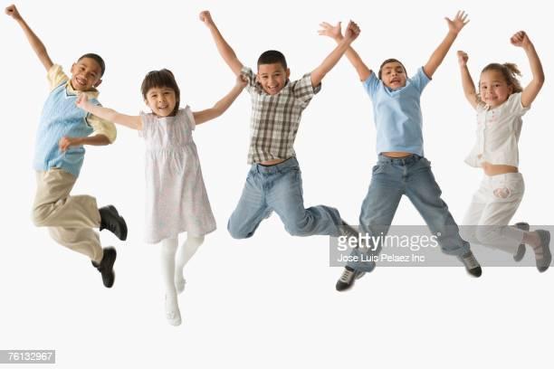 Multi-ethnic children jumping