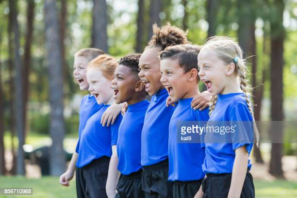multi-ethnic children on soccer team - minority groups stock pictures, royalty-free photos & images