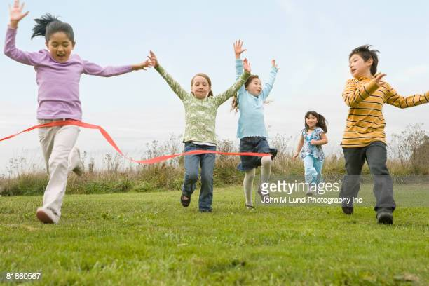 Multi-ethnic children running race