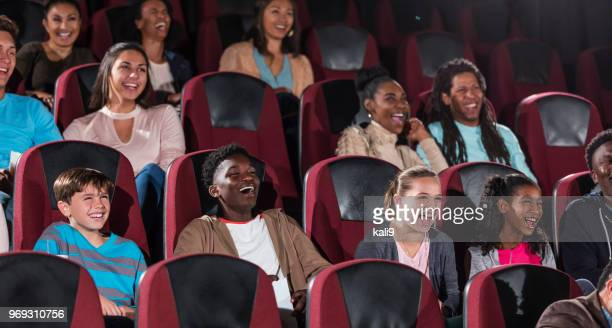 multi-ethnic children, teens, young adults in theater - children theatre stock photos and pictures