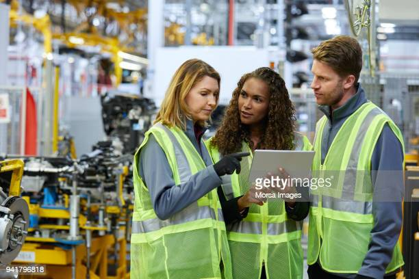 multi-ethnic colleagues discussing over tablet - mechanical engineering stock pictures, royalty-free photos & images