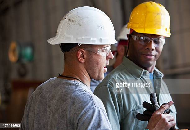 Multi-ethnic construction workers talking