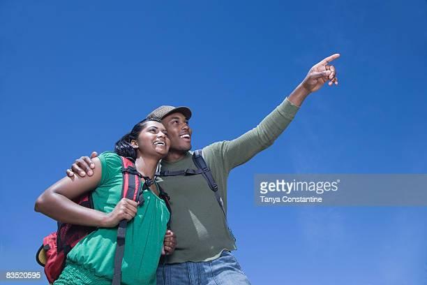 Multi-ethnic couple backpacking