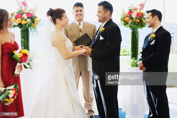 multi-ethnic couple getting married - wedding vows stock pictures, royalty-free photos & images