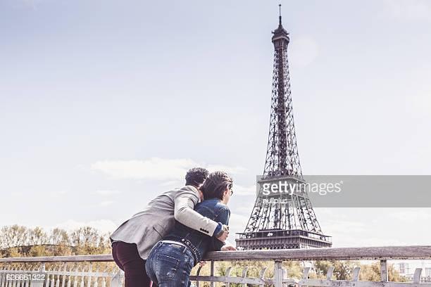 Multi-ethnic couple having fun in Paris near Eiffel Tower