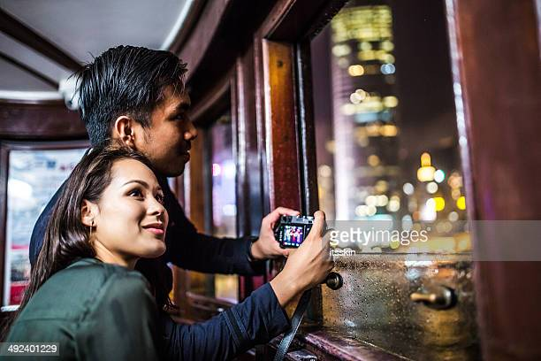 Multi-ethnic couple in Hong Kong traveling ferry