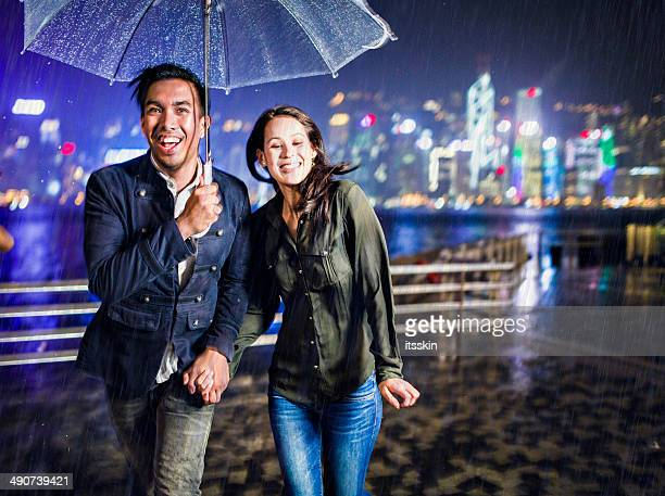 Multi-ethnic couple in Hong Kong under the rain