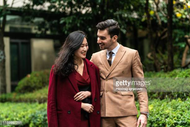 multi-ethnic couple in love - formal stock pictures, royalty-free photos & images
