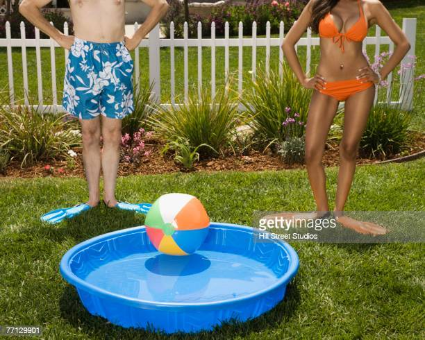 Multi-ethnic couple next to kiddie pool