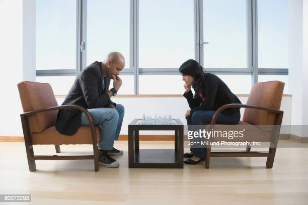 Multi-ethnic couple playing chess