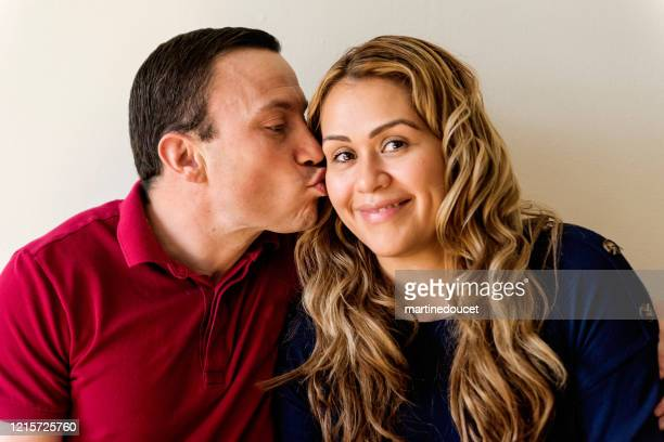 """multi-ethnic couple portrait. - """"martine doucet"""" or martinedoucet stock pictures, royalty-free photos & images"""