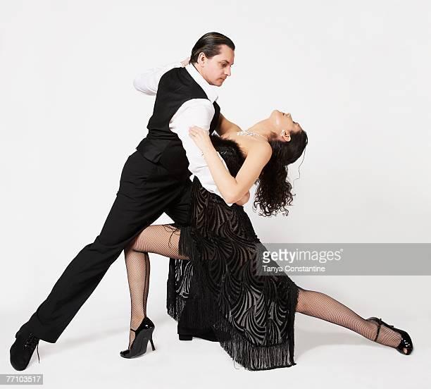 Multi-ethnic couple tango dancing