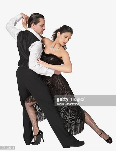 multi-ethnic couple tango dancing - tango tanz stock-fotos und bilder