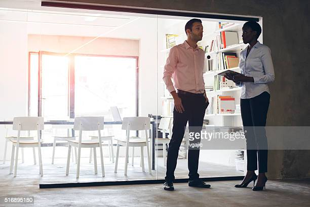 Multi-ethnic Coworkers talking in their office.