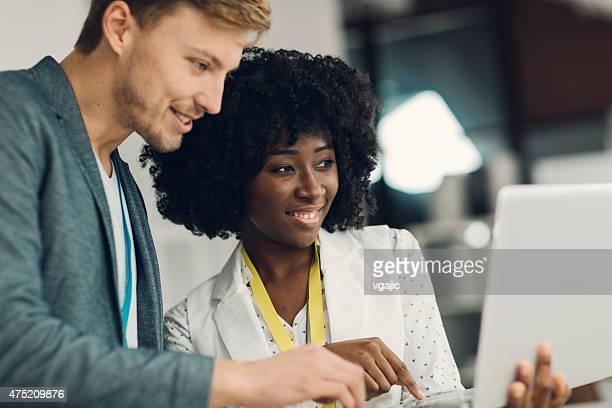 Multi-ethnic Creative Start-Up Business Team Working.