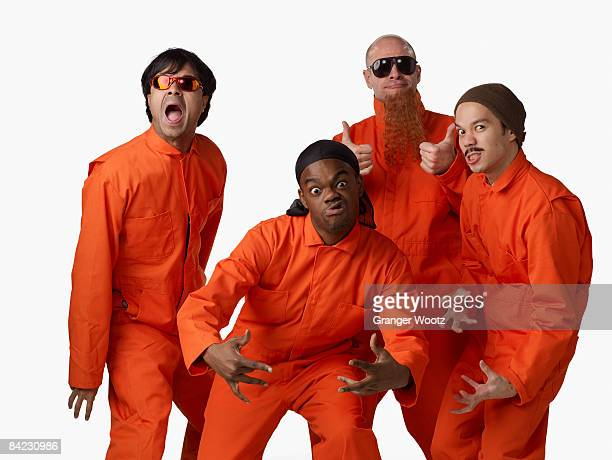 multi-ethnic criminals in prison uniforms - black jumpsuit stock pictures, royalty-free photos & images