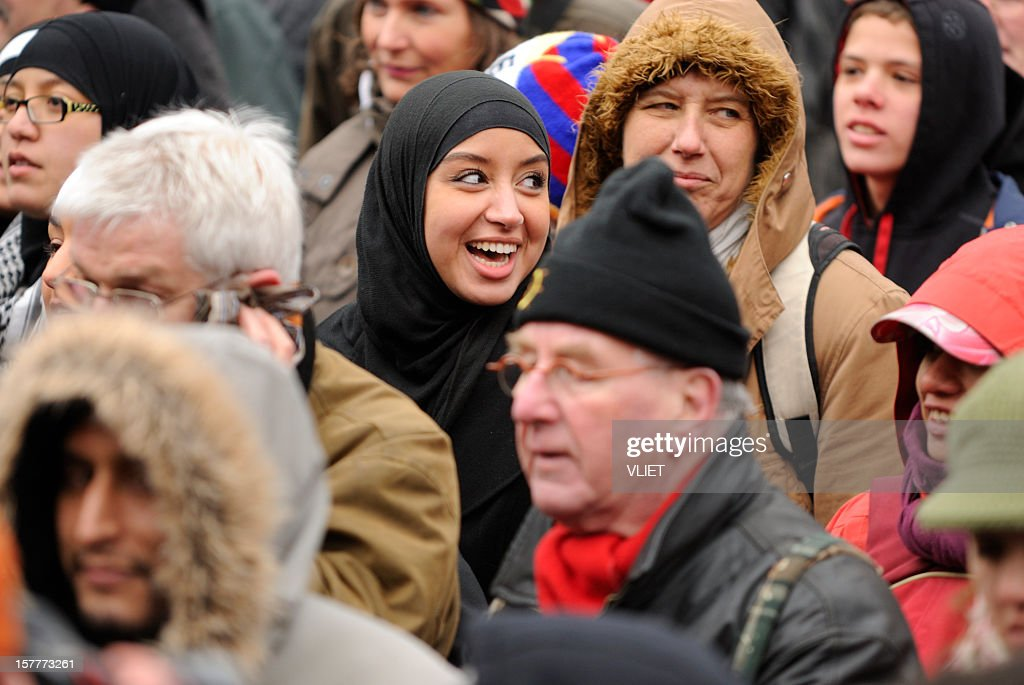 Multi-ethnic crowd participating in an anti-racism protest : Stock Photo