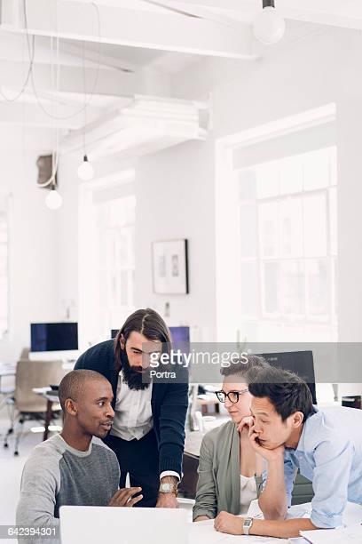 Multi-ethnic designers discussing creative work
