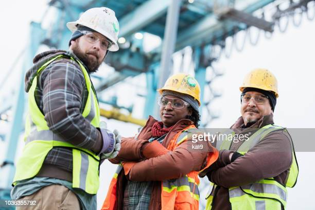 multi-ethnic dock workers at shipping port - longshoremen stock pictures, royalty-free photos & images