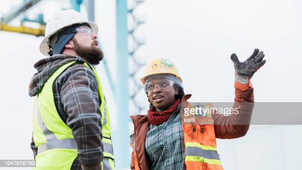 multi-ethnic dock workers at shipping port - work glove stock pictures, royalty-free photos & images