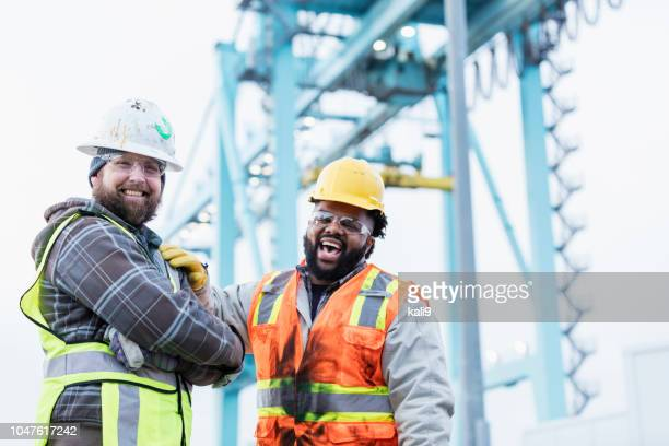 multi-ethnic dock workers at shipping port - commercial dock stock pictures, royalty-free photos & images