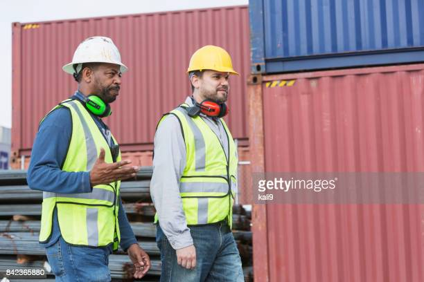 Multi-ethnic dock workers at shipping port