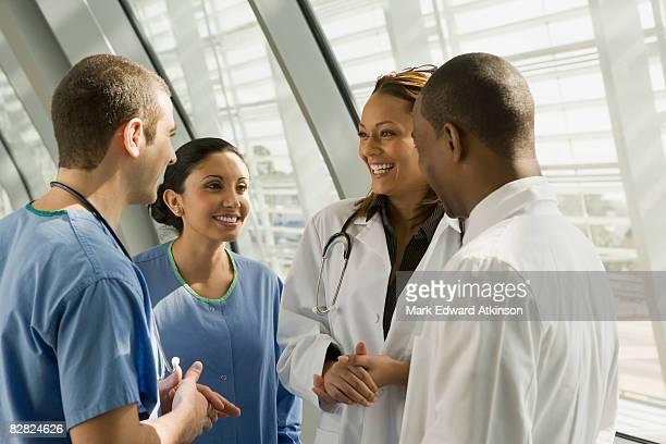 Multi-ethnic doctors and nurses talking