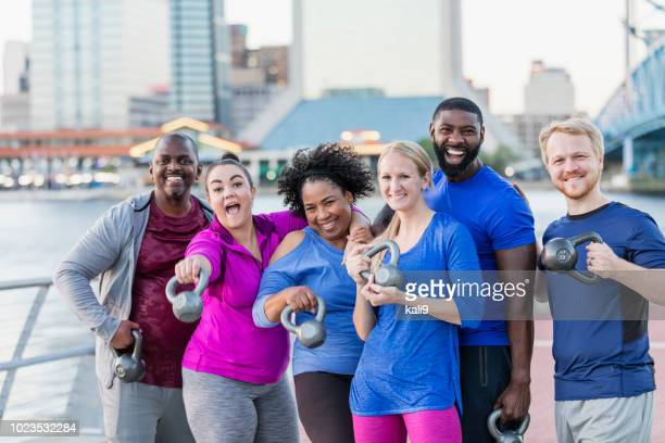 multi-ethnic exercise class,  with kettlebells - mid adult stock photos and pictures
