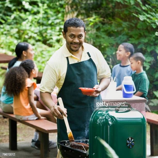 Multi-ethnic family barbecuing in park