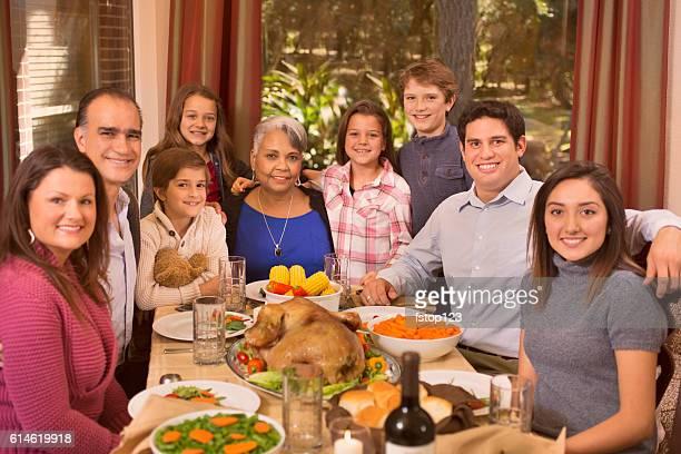 Multi Ethnic Family Enjoying Thanksgiving Dinner At Grandmothers Home
