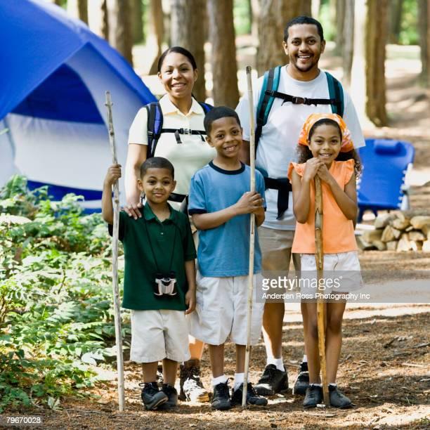 Multi-ethnic family holding walking sticks