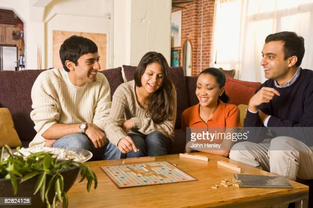 Multi-ethnic family playing board game