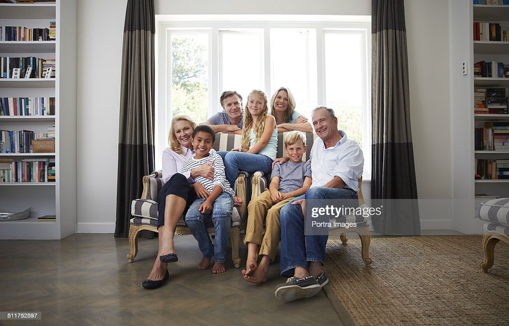 Multi-ethnic family smiling in house : Stock Photo