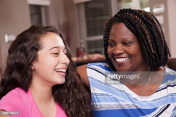multi-ethnic family.  teenage girls and mom at home.  hugs. - social services stock photos and pictures
