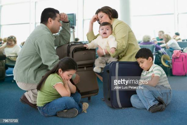 multi-ethnic family waiting in airport - toddler at airport stock pictures, royalty-free photos & images