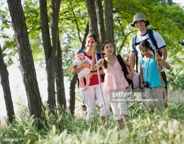Multi-ethnic family walking in woods