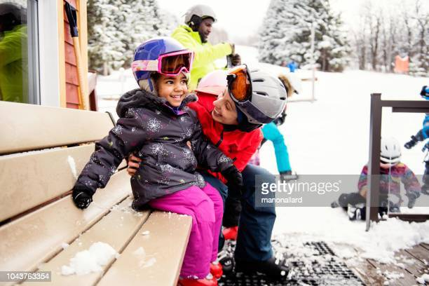 multi-ethnic family with their friends skying - winter sport stock pictures, royalty-free photos & images