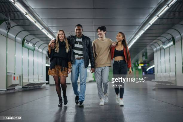 multi-ethnic friends at subway - medium shot stock pictures, royalty-free photos & images