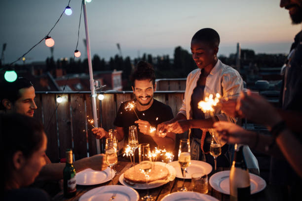 multi-ethnic friends enjoying rooftop party - best friend birthday cake stock pictures, royalty-free photos & images