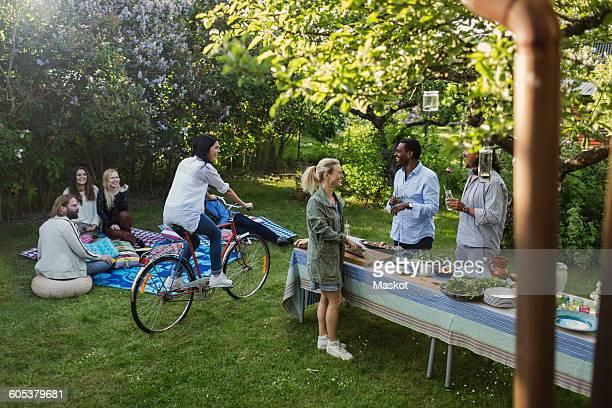 Multi-ethnic friends enjoying summer party at yard