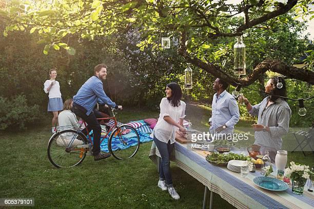 Multi-ethnic friends enjoying summer party in backyard