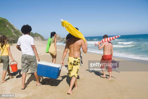 multi-ethnic friends enjoying the beach - esky stock photos and pictures