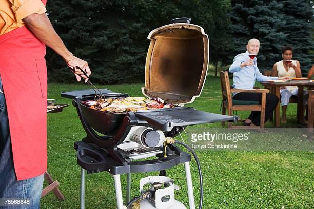 Multi-ethnic friends having barbecue