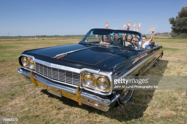 multi-ethnic friends in low rider car - low rider stock pictures, royalty-free photos & images