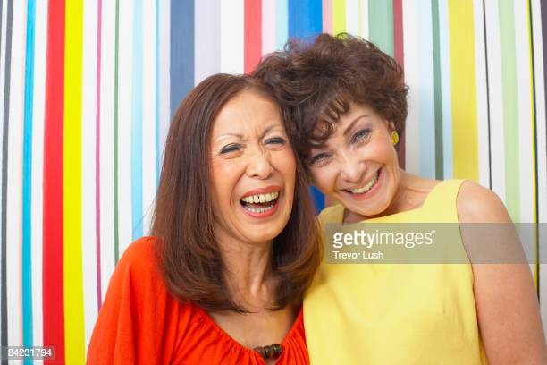 multi-ethnic friends smiling - only mature women stock pictures, royalty-free photos & images