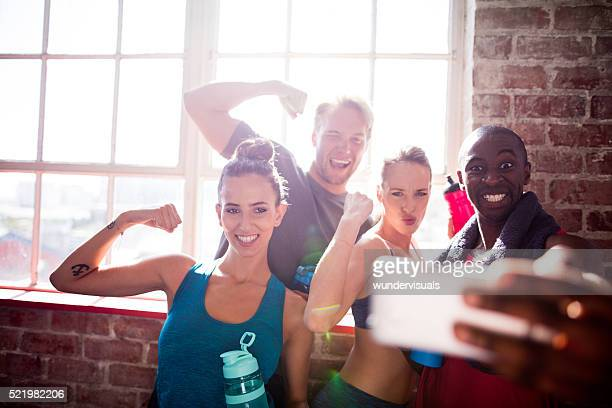 Multi-ethnic friends taking selfie at the gym